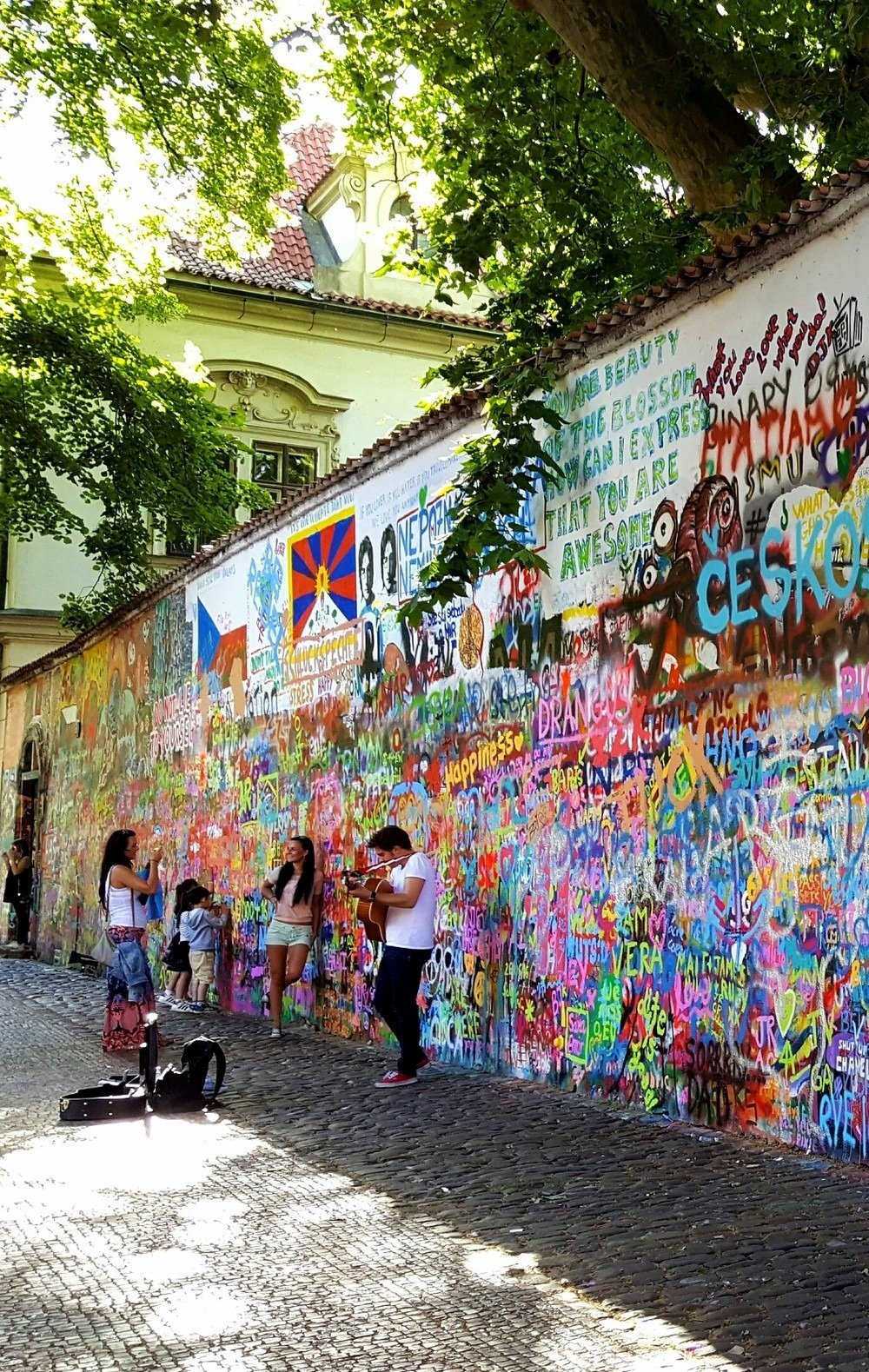 The John Lennon Wall in Prague continue to attract today's youth seeking an outlet for artistic expression.