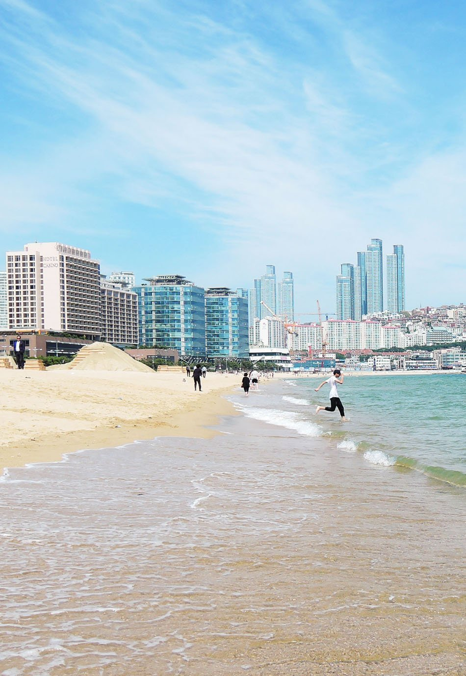 Visit Haeundae Beach, one of Busan's beautiful beaches. Spend an afternoon beach-bumming and people-watching and enjoy Haeundae's fine white sand. Click through for a detailed guide on how to visit Busan in 3 days.