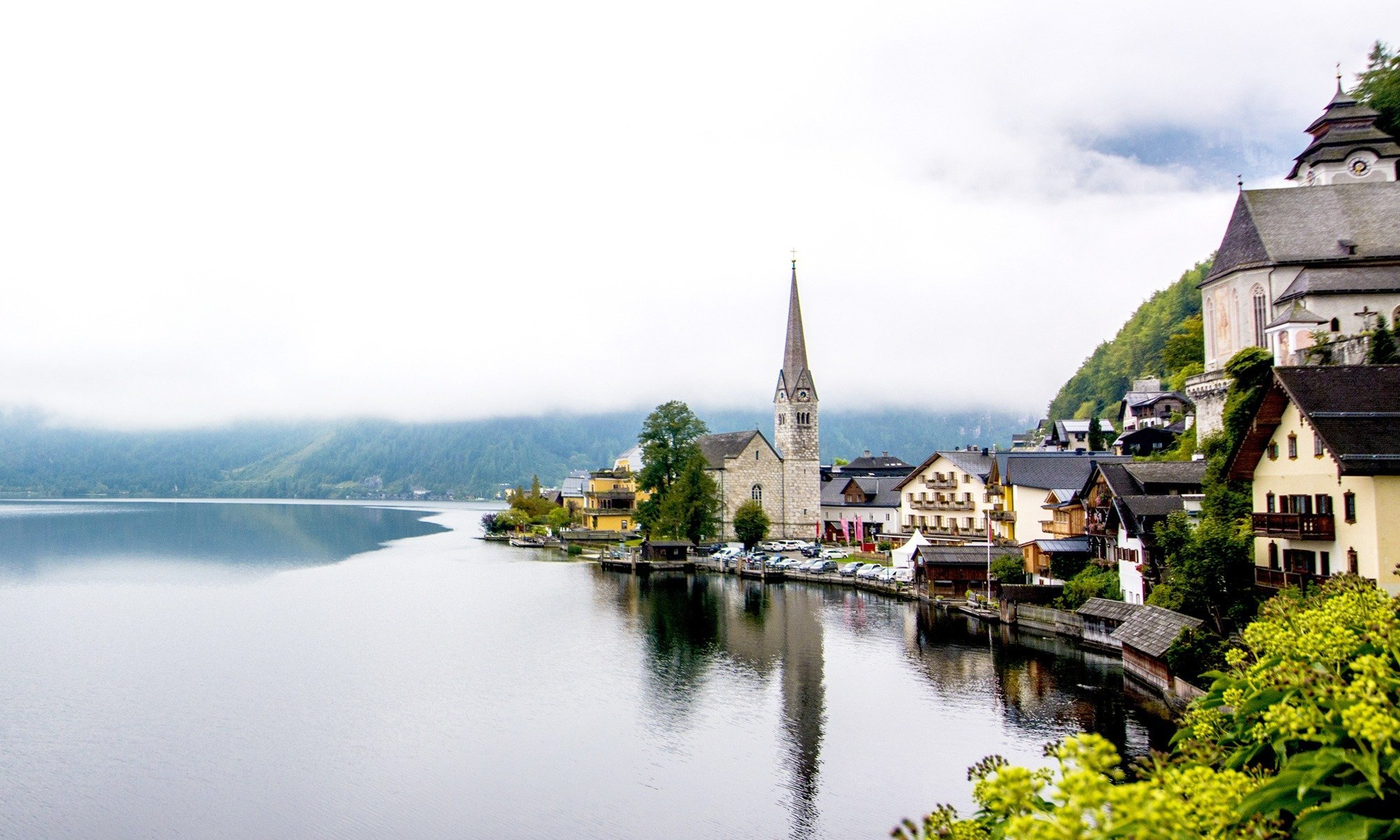 A calm blue lake mirroring the sky, mountain ranges setting a picture-perfect background, and pastel lakeside houses lending the historic town a storybook vibe – I did my best but words fail to do this town justice. If you're in for a visual tour or ready to start planning your trip, this Hallstatt travel guide will surely leave you in love with this town.